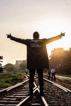 Free Man Standing On Railway Raising Hands Stock Photo - 126190550