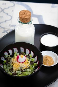 Free Vegetable Salad Beside Milk Bottle And Brown Sauce Dip On Round Black Tray Royalty Free Stock Photos - 126190618