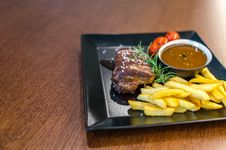 Free Grilled Beef With Fries And Sauce On Black Ceramic Plate Royalty Free Stock Image - 126190626