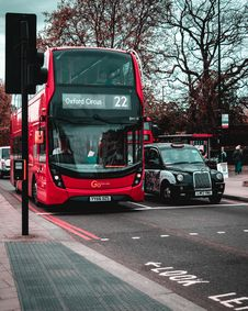 Free Red Double-Decker Bus Beside Black Taxi Cab On Asphalt Road Stock Image - 126190641