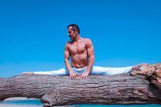 Free Man Splitting Legs On Brown Wood Log Stock Photography - 126190642