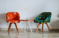 Free Two Assorted-color Padded Chairs Near Side Table Stock Photos - 126190653