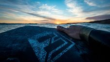 Free Person Holding Black And Gray Board Facing Blue Sea Under Blue Sky Stock Photo - 126190730