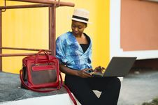 Free Woman Sitting Beside Bag And Using Laptop Royalty Free Stock Photography - 126190747