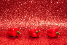 Free Three Red Bell Peppers On Red Surface Stock Photography - 126190752