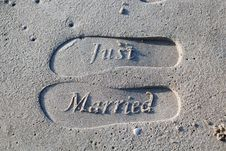 Free Just Married Foot Prints On Sand Stock Images - 126190954