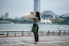 Free Woman Standing Taking Picture Of Scenery Stock Photography - 126190972