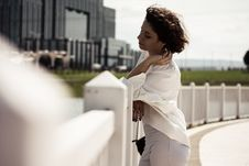 Free Woman Leaning On White Wooden Picket Fence Royalty Free Stock Images - 126191009