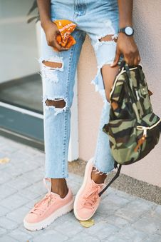 Free Woman Leaning On Wall Carry Camouflage Backpack Stock Photos - 126191063