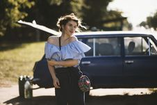Free Woman In Blue Blouse Standing Near Blue Station Wagon Stock Photo - 126191110