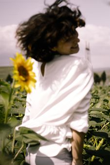 Free Photo Of Woman On Sunflower Field Royalty Free Stock Image - 126191216