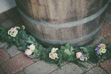 Free Pink And White Petaled Flowers Swag Beside Brown Wooden Barrel Stock Photos - 126191283