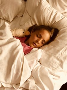 Free Girl Sleeping On Bed Stock Photography - 126191332