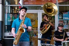 Free Three Man Playing Drums And Wind Instruments In Front Of Store Stock Image - 126191361