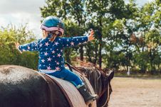 Free Girl Riding Black Horse Royalty Free Stock Photo - 126191565