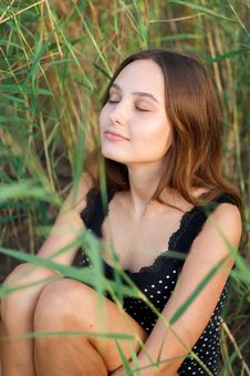 Free Photo Of Woman Sitting On Green Grass Stock Images - 126191644