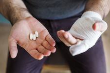 Free Man Holding Three White Medication Pills Royalty Free Stock Photography - 126191787