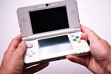 Free Person Holding Nintendo Ds Stock Photos - 126191793