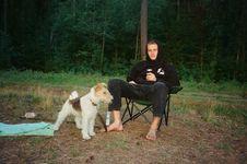 Free Man Sitting Beside Brown And White Dog Royalty Free Stock Image - 126191816