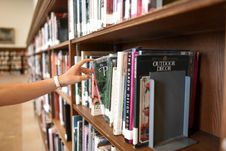 Free Person Holding Book From Shelf Royalty Free Stock Image - 126191866