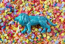 Free Green Lion Figure On Assorted-color Sprinkles Stock Photography - 126191882