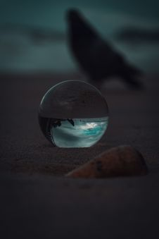 Free Glass Ball On Sand Stock Photo - 126192090