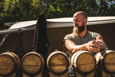 Free Man Standing In Front Of Oak Barrels Royalty Free Stock Images - 126192099