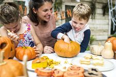 Free Person Holding Pumpkin Beside Woman Stock Photo - 126192100