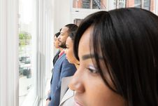 Free Group Of People Lining Up Near Glass Window Stock Photo - 126192120
