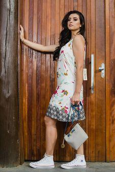 Free Woman Holding Handbag Near Brown Wooden Door Stock Photos - 126192123