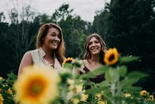 Free Two Women Standing On Sunflower Garden Stock Photo - 126192180