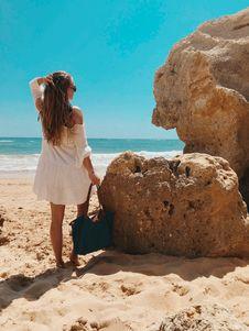 Free Woman Standing Beside Rocks Near Beach Stock Photos - 126192243