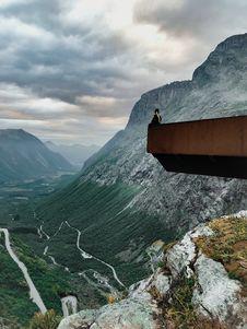 Free Man Sitting On The Edge On Stone Stock Photos - 126192293
