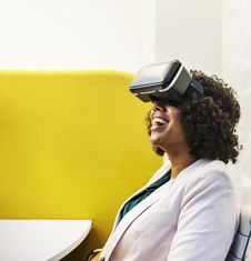 Free Smiling Woman Using Virtual Reality Headset Stock Photo - 126192310