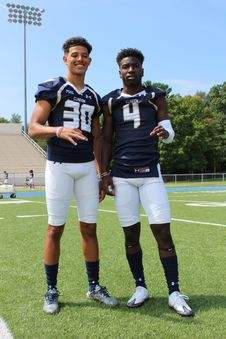 Free Two Football Players Taking Picture On Football Field Royalty Free Stock Photo - 126192335
