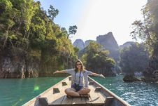 Free Photo Of Woman Sitting On Boat Spreading Her Arms Stock Photo - 126192360