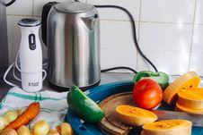 Free Gray Metal Electric Kettle Near Sliced Vegetables Stock Photo - 126192370