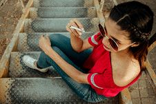 Free Woman Holding Cigarette Sitting On Stairs Royalty Free Stock Photography - 126192417