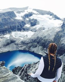 Free Woman Wearing Blue Vest Standing On Cliff Stock Photo - 126192420