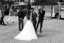 Free Grayscale Photography Of Man Wearing Black Suit Kissing Woman Wearing White Wedding Dress Stock Image - 126192451