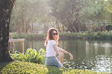 Free Woman In White T-shirt Near Swamp Lake Royalty Free Stock Photography - 126192517