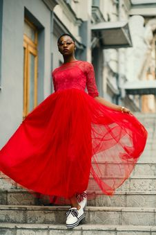 Free Woman Wear Red Elbow-sleeved Dress Walking On Stair Stock Images - 126192564