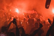Free Crowd Holding Flares While Gathered On Open Area At Night Time Stock Image - 126192711
