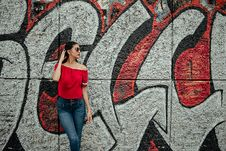 Free Woman Wearing Red Off-shoulder Shirt And Blue Denim Stone-wash Jeans Near Red And Gray Graffiti Wall Royalty Free Stock Photos - 126192828