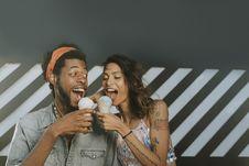 Free Man And Woman Eating Ice Creams Royalty Free Stock Photo - 126192975