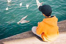 Free Boy Sitting Near Body Of Water Royalty Free Stock Photos - 126192978