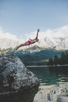Free Man Wearing White And Red Board Short Diving From Rock Formation Royalty Free Stock Photography - 126193067