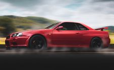 Free Selective Focus Photography Of Red Nissan Gt-r R34 Skyline Running On Road Royalty Free Stock Photography - 126193137