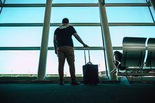 Free Man Holding Luggage Bag Stock Image - 126193201