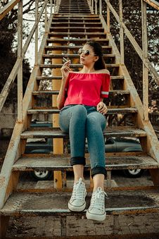 Free Woman Sitting On Yellow And Black Stairway Royalty Free Stock Images - 126193209